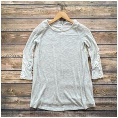 LISTING! NWT Gray Lace Sleeve Thermal Top NWT Gray Lace Sleeve Thermal Top. Cozy waffle knit thermal top with adorable lace sleeve details! 3/4 length sleeves, fits true to size. Material is Rayon/Polyester/Spandex blend. Available in S (0-4), M (6-8), L (10-12). No Trades and No Paypal⭐️PLEASE DO NOT BUY THIS LISTING, COMMENT WHEN READY TO BUY AND I WILL MAKE A NEW LISTING TO BUY⭐️ Tops Tees - Long Sleeve
