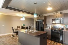 Traditional Kitchen with Kitchen island, Woodhaven Plank Wood Ceiling, European Cabinets, Laminate countertops, One-wall