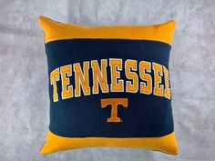 This University of Tennessee recycled sweatshirt pillow is the perfect gift for a graduate, student, or alumni! This also makes a great gift for the student who has decided to attend University of Tennessee. I up-cycle sweatshirts into pillows and I found this beautiful pre-owned appliquéd Tennessee Msu College, College Student Gifts, Dorm Pillows, Throw Pillows, Tennessee Colleges, Michigan State University, Care Packages, Tennessee Volunteers, Fabric Bags