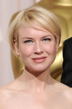 Renee Zellweger's cut abides by the old rule: Short hair works on round faces as long there is some kind of bang and it isn't cut right at chin-length. Her soft bangs give her face angles without adding any width to the sides of her face. #ReneeZellweger #RoundFaces