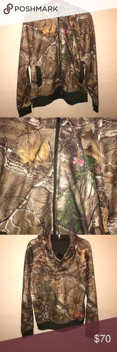 {Under Armour} Camo w/ pink detail full zip hoodie ▪️Under Armour ▪️Women's size XL ▪️Full zip semi-fitted hoodie ▪️Two pockets w/ zipper closure ▪️Solid cuffs & hem ▪️Condition: NWOT ▪️This jacket is no longer made.   Last picture for styling purposes.  Cozy and perfect for hunting or just for staying warm in style.   🛍Bundle 2 or more items for a discount. Spend over $60 for discounted shipping.🛍 Under Armour Jackets & Coats