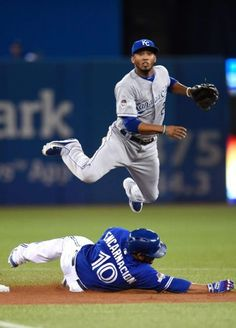 ALcides Escobar, KC/Edwin Encarnacion, TOR///Game 5 ALCS at TOR, Oct 21,2015   (frank gunn/the canadian press via ap)