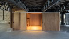 Schemata Architects adds plywood boxes to redefine House in Nobeoka