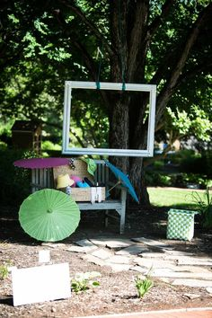 """Hang a large frame from a tree to create an inexpensive """"photo booth""""! We had hats, parasols, and other props on hand, and everyone loved it!   Tags-- garden wedding, photo booth; 2013 wedding; outdoor; games; reception"""