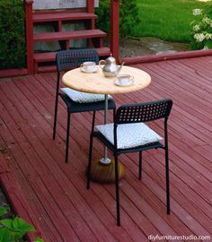 DIY patio furniture bistro table made of wood salad bowl, plumbing pipe/flanges, and pine panel table top.