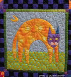 Cats Rule, made by Kathy Mack, quilted by Shannon Freeman. Folk Art Cats design by John Simpkins. 2014 RCQG, closeup photo by Quilt Inspiration