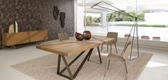 Dining table with top in thick oak veneer on particle board, grooved and stained (many stains available).  Synchronized opening of the tops, and integrated ...