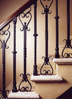 Custom iron balusters with stained wooden hand rail.  Travertine treads,plaster risers/walls/carriage.  By Norman Askins/Atlanta architect