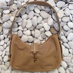 Gucci Hobo Bag Classy Authentic Gucci perforated leather tan purse with gold hardware. Soft perforated unlined leather bag with coin purse connected to inside that can be taken out of bag to get belongings and is permanently attached. The web strap has leather trim. I❤️this bag. Also comes with original dust bag  pre-loved condition. Note front clasp has dings as shown in photo. Authentic ✨ purchased at Gucci boutique Gucci Bags Hobos