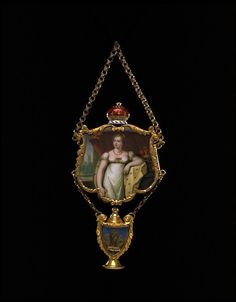 This memorial pendant was made in 1817 to commemorate the death of Princess Charlotte. She was the only daughter of the Prince of Wales (the future George IV) and his wife, Caroline of Brunswick. Charlotte had married Leopold of Saxe-Coburg, the future king of the Belgians, in 1816 and died in childbirth the following year. Three locks of her hair have been curled into the shape of Prince of Wales' feathers. These are mounted in the vase that hangs below the miniature.