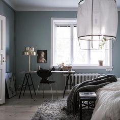 A calm Swedish home with a blue bedroom (and work space).