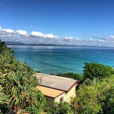 House in Byron Bay, Australia. A two story beach shack situated underneath the Lighthouse with panaromic views over Wategoes Beach to Julian Rocks. A short 50 metre walk to wategoes beach. Ideal for a couple looking for a relaxing beach holiday.  A small tree house set back one...