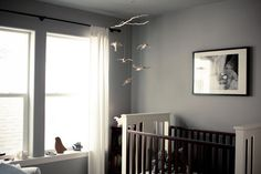 This is the crib I have and, coincidentally, the colour I'm planning on painting the bedroom to go with the silver tree wallpaper.