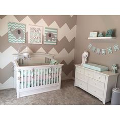 How adorable is this nursery? Thanks to our fan Julie for sharing a photo of her Carousel Designs custom bedding! We are loving the accent wall and coordinating decor. Well done, Julie! #fanphoto #carouseldesigns #custombedding #designyourown #chevron