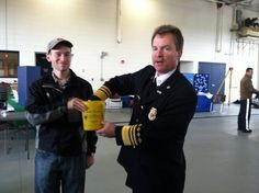 Liberty Twp Fire Department Open House 2012.  EMA Deputy Director Sean Miller holds the container while Chief Jensen draws the winning name for the weather radio raffle.