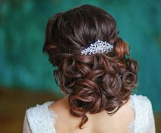 Beautiful look from the back of a stunning bridal updo with tons of curls from MOdweddings. #weddinghairstyles, #bridalupdos, #weddingupdos.