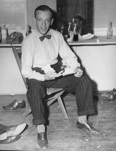 FRED ASTAIRE TRIVIA: Have you noticed the taps Fred is wearing on his shoes? His street shoes are beside him on the floor.