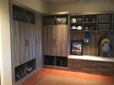 This Stromboli melamine mudroom has something for everyone: hooks for backpacks, baskets for gloves, cubbies for helmets & cabinets for coats.  Learn more: https://www.closetfactory.com/mudrooms/