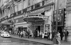 Theatregoers waiting outside the Criterion Theatre, London, where 'The Real Inspector' by Tom Stoppard is playing.