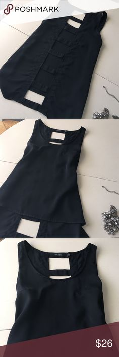 💥Sale💥 Peekaboo Lattice Back Black Tank Top Peekaboo lattice back black tank top. Size Small. Pop a bright colored cami underneath + accessories and you have your new favorite basic black top. Small nail polish stain on front as pictured. 🚫No offers on 💥1-day Sale price! 🚫 Anthropologie Tops Tank Tops