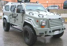 This vehicle (GURKHA)is armored by Armet Armored Vehicles Inc, of Largo Florida.Their president is Frank Skinner (proud former member of the US Marines). Armored to Euro B7+ with blast protection. Armored turret against AP rounds.