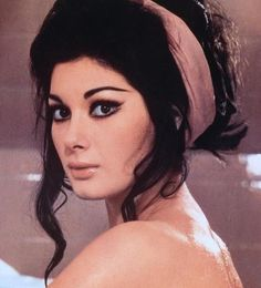 Edwige Fenech - careful googling her. She often showed her assets.