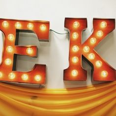 25 Tutorials for a DIY Carnival, like setting up classic carnival games and making these glowing marquee letters.