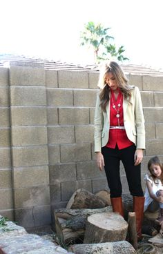 Red blouse with a tan blazer, silver belt and brown boots