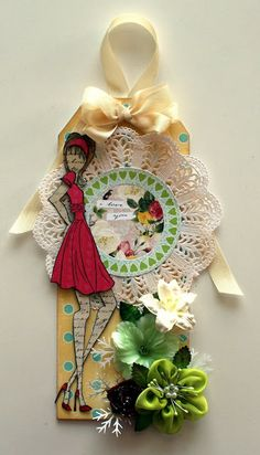 Prima Marketing Art doll tag, Julie Nutting, created for The Scrapbook Store using Websters Pages, Modern Romance papers, Prima and Green Tara flowers, Copics, and Seam Binding.