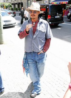 Tapping into the cowboy theme: Johnny had a couple of bandanas tied to his distressed jeans and wore the same khaki hat he's taken with him throughout his promotional tour