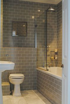 Clean and simple lines for this no nonsense family bathroom - brick laid tiles. Katharine & James' Glamorous Family Home in London : Apartment Therapy Bad Inspiration, Bathroom Inspiration, Family Bathroom, Master Bathroom, Bathroom Grey, Master Baths, Classic Bathroom, Basement Bathroom, Apartment Therapy