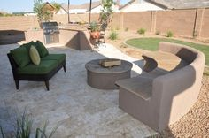 Travertine patio with firepit and bbq