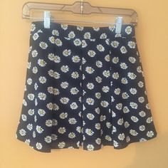 Pleated daisy mini skirt  Worn once. True to size small.  Zipper back Skirts Mini