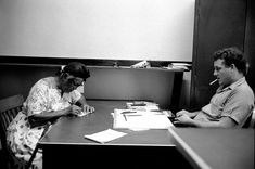 Overseen by a white registrar, a black citizen trained by CORE fieldworkers answers a rigorous questionnaire in an attempt to register to vote during freedom summer in Baton Rouge, La., 1964.