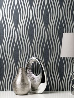 This beautiful Quartz Wave Wallpaper will add a stylish finishing touch to most rooms of your home. The design features an elegant curved pattern of wavy lines with a metallic silver finish and glitter detailing. This is set on a matte paper in a rich navy blue tone that is infused with glitter particles and has a textured fabric effect finish. This high quality vinyl wallpaper could be used to create a feature wall or to decorate an entire room. Waves Wallpaper, Vinyl Wallpaper, Crushed Velvet Wallpaper, Metallic Wallpaper, Pattern Matching, Wave Design, Line Patterns, Blue Tones, Designer Wallpaper