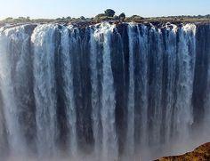 Victoria Falls kan sees fra både Zambia- og Zimbabwesiden, og dere kan kjøpe turer, som dekker en eller begge sider. Prøv evt. å gå turen over fra Zambia til Zimbabwe, over Victoria Falls Bridge.   Les mer ved å følge lenken øverst Victoria Falls, Dere, Niagara Falls, Safari, Waterfall, Nature, Outdoor, Traveling, Outdoors