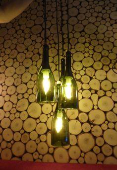 Witajcie - oto moja wersja lampy z butelek od wina na tle mojej ściany z plasterków topoli. Pozdrawiam Piotrek