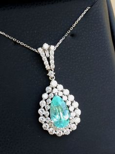 40 ct paraiba tourmaline necklace white gold with diamonds paraiba tourmaline necklace white gold with diamonds paraiba jewelry pinterest tourmaline necklace white gold and diamond aloadofball Image collections