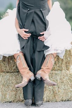 he he cute wedding photo ... cowboy wedding boots wrapped around the groom | Clane Gessel photo