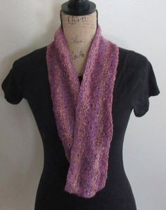 Handknit Knit/purl textured scarf donated to provide funds to help fight human trafficking.