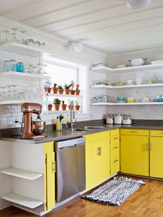 This Victorian-style home's interiors has been updated with fun projects and modern updates like these bright and cheery yellow kitchen cabinets.