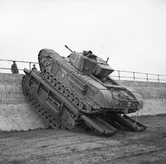 A Churchill tank uses a Churchill Ark to scale a sea wall, 79th Armoured Division, Saxmundham area, 11 March 1944.