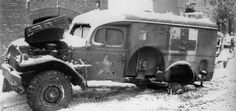 Dodge 3/4-Ton Ambulance riddled with bullets. Picture taken during the Battle of the Bulge,