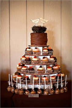 """Cupcake display with cake pops.  We can help achieve this look at Dallas Foam with cake dummies, cupcake stands and cakeboards. Just use """"2015pinterest"""" as the item code and receive 10% off your first order @ www.dallas-foam.com. Like us on Facebook for more discount offers!"""