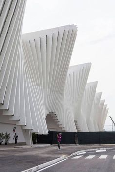 New High Speed Train Station in Italy. Roof composed of 19 modules, each made of stepped series of 25 stell elements, creating a dynamic curve. Opened 2013. Architect: Santiago Calatrava