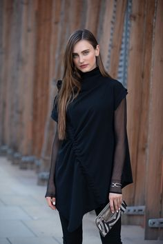 This asymmetric fashion boutique designer wool-blend black top is a statement piece and a perfect example of avant-garde vision. The unique nice top is draped one one side to underline the silhouette. For the perfect casual stylish top outfit. By ART POINT womens brand #fashiondiscovery #Art_point #Top #fashion #style #designer_tops #ladies_tops #nice_tops #unique_tops #boutique_tops #tops_fall #outfits_tops #womens_fall_tops #womens_fashion_tops #fall_fashion_tops #casual_tip… Boutique Tops, Boutique Design, Fall Tops, Ladies Tops, Fall Fashion, Womens Fashion, Stylish Tops, Black Trousers, Women Brands