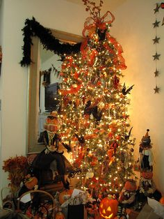 Halloween Tree - great idea - then use the tree for decorating with leaves, etc, for Thanksgiving...then ornaments for Christmas !