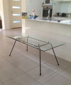 Kurrlson mcm inspired contemporary glass on iron rod coffee table 130 x 66 x 51 cm