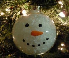 """snowman…. Another pinner said, """"I still have one of these that my youngest daughter made in elementary school, so its around 10 years old. They used shredded paper inside. Its actually one of my favorite homemade Christmas ornaments and goes on the front of the tee every year."""" 