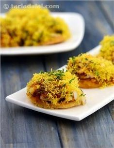 Tangy, crisp and tongue-tickling are the first words that come to mind when one thinks of this chat-pata snack. An arrangement of puris or papdis loaded with potatoes and chutneys, garnished with crispy sev and peppy coriander, Sev Puri is a snack worth many accolades! A steady stream of praise usually follows every mouthful, so full of crisp papdi, fresh chutneys and crunchy veggies like onions and raw mangoes. But some just lose themselves in the myriad flavours and textures, and stay ...